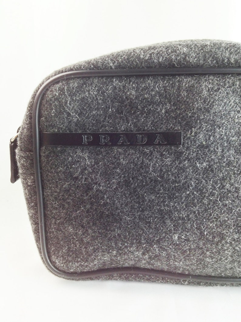 3cfd6d0a944 Handsome Prada Classic Wool Grey Flannel Zippered Pouch Bag.