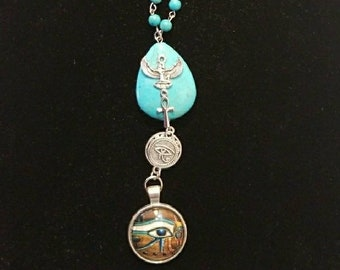 Ancient Egyptian symbolic  Goddess Maat,  ankh and Silver Eye of Ra and bottom  Eye of Ra  necklace