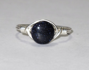 Sterling silver and blue goldstone wire wrapped ring