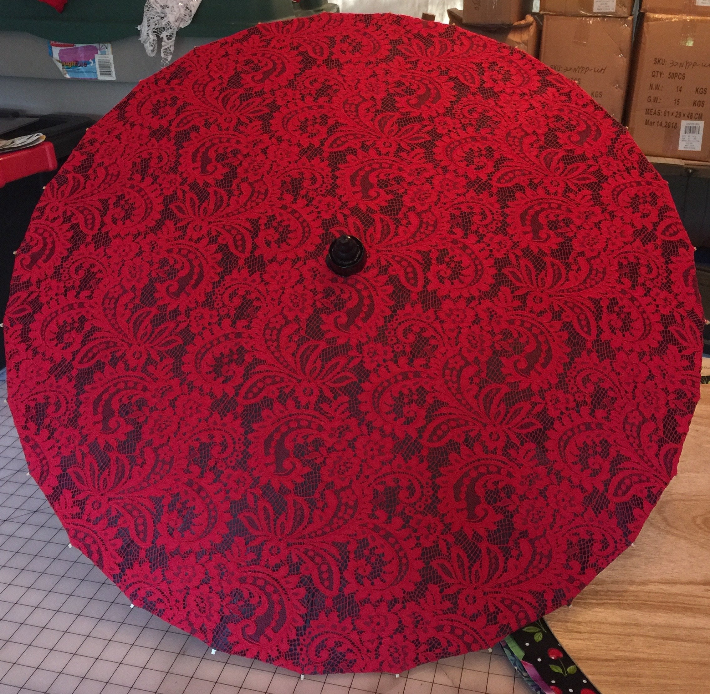 Red Filagree On A Black Parasol