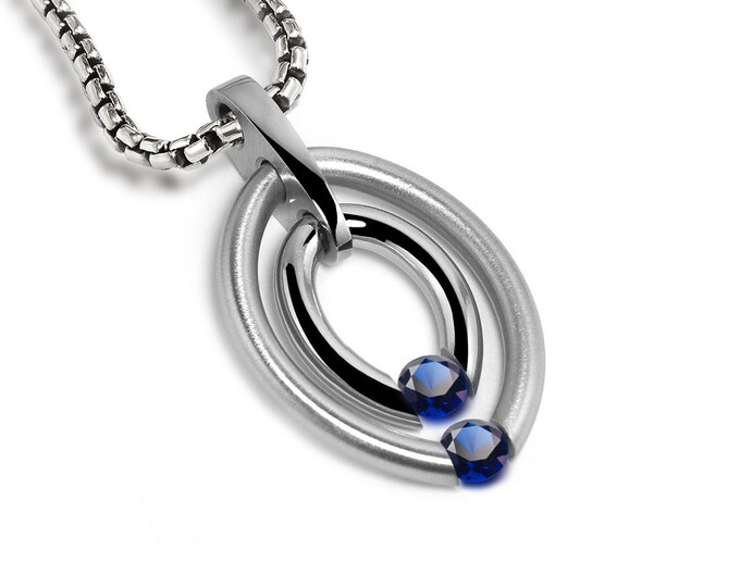Two Blue Sapphire Tension Set Double Birthstone Pendant by Taormina Jewelry