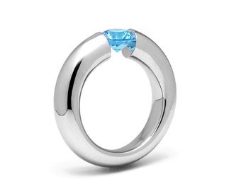1ct Blue Topaz Tension Set Tapered Engagement Ring in Stainless Steel by Taormina Jewelry