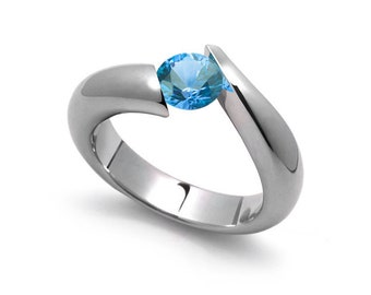 1ct Bypass Blue Topaz Tension Set Ring in Two Tone Stainless Steel