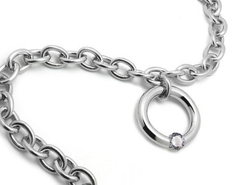 Stainless steel oval link charm bracelet with tension set white sapphire