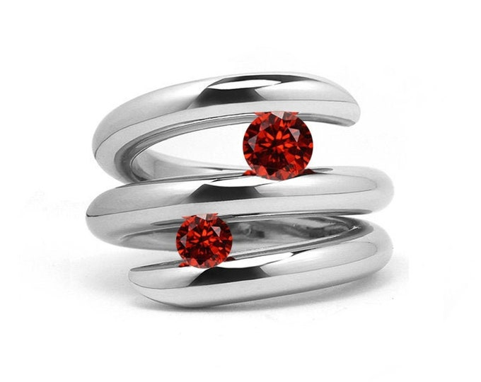 Two Garnet double row bypass tension set ring in stainless steel