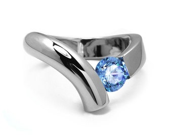 1ct Blue Topaz Bypass Tension Set Ring in Two Tone Stainless Steel by Taormina Jewelry