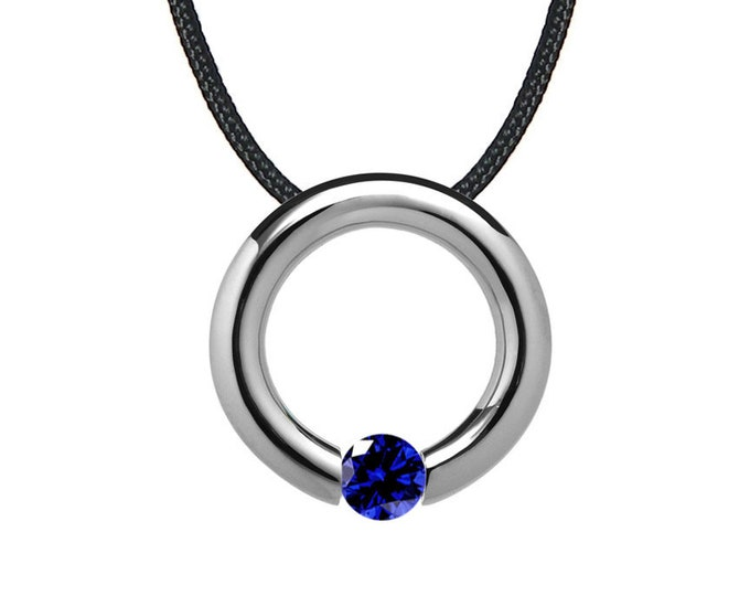 Blue Sapphire Tension Set Circle Pendant in Stainless Steel by Taormina Jewelry