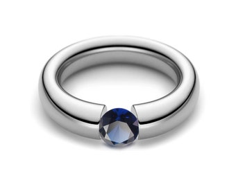 1.5ct Blue Sapphire Tension Set Tapered Engagement Ring in Stainless Steel