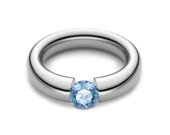 1ct Blue Topaz Tension Set Tapered Engagement Ring in Stainless Steel