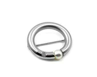 White Pearl Tension Set Brooch in Stainless Steel