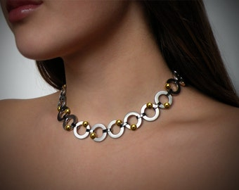 Round Link Necklace with Tension Set Gold Spheres in Stainless Steel by Taormina Jewelry