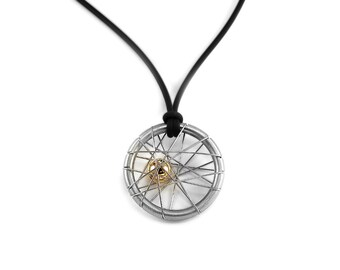 Unique Intricate Wire Two Tone Pendant  in Stainless Steel with Gold Sphere