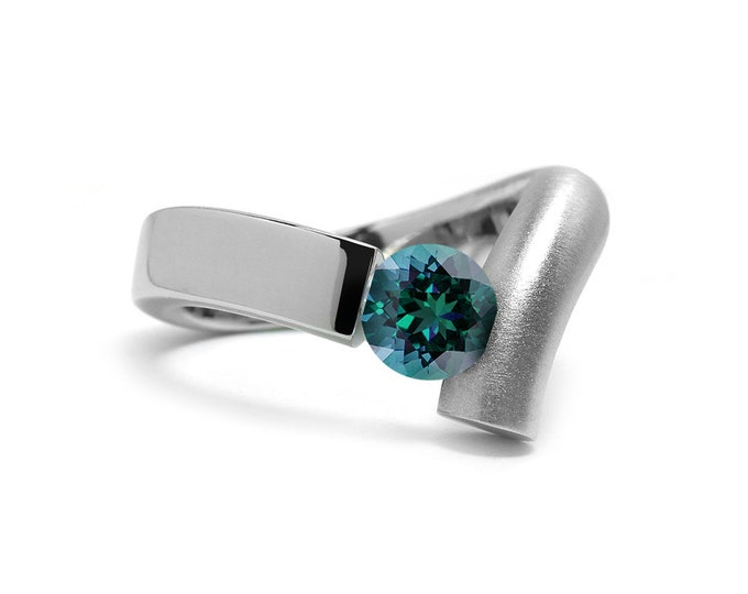 Stainless Steel Ring - 2 Tone finish with Tension Set Round Blue Topaz