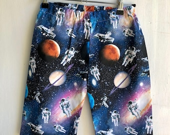 Boys shorts , outer soace and astronauts