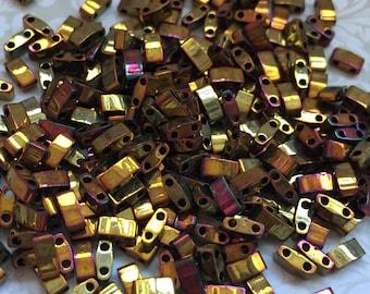 HTL462 10 Grams Miyuki Tila Half Cut Beads-Gold Opaque Iris Metallic