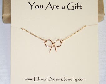 You are a Gift Tiny Bow charm necklace. Gold or silver. Special Message. Wire wrap. Dainty