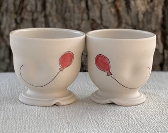 Porcelain short goblet with inlaid balloon design  and clear and red glazes, ice cream dish, wine goblet
