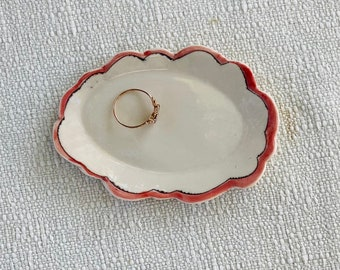 Charming ring dish with carved rim and inlaid whimsical design and pink and clear glaze