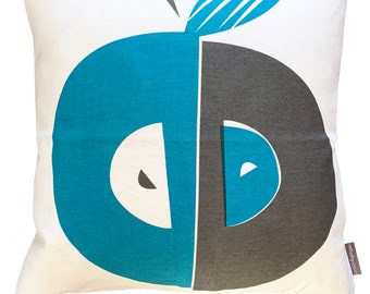 Apple cushion in teal and dark grey on white linen
