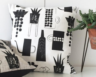 Botanics and ceramics cushion on white linen union