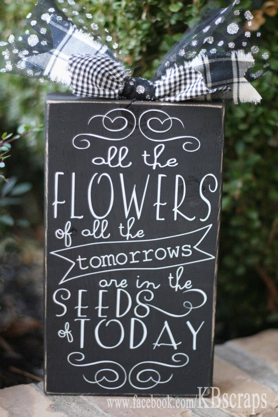 all the flowers of all the tomorrows are in the seeds of today
