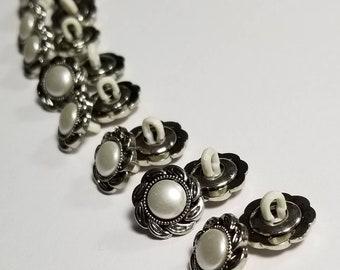 Pearl Look Buttons. Plastic Shank Back Buttons. Silver Look with Pearl Look Center.