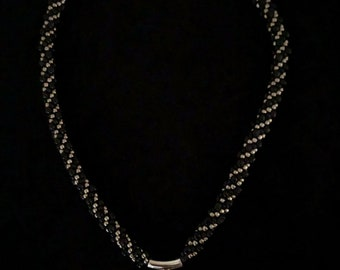 Kumihimo Beaded necklace with Rhodium plated pendant with fused dichroic glass insert