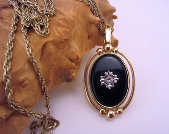 Vintage Avon jewelry. Black and gold pendant. Reversible pendant. Clear rhinestone. Long necklace. Gold rope chain.
