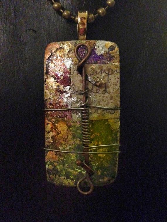 Fusion glass collage pendant.