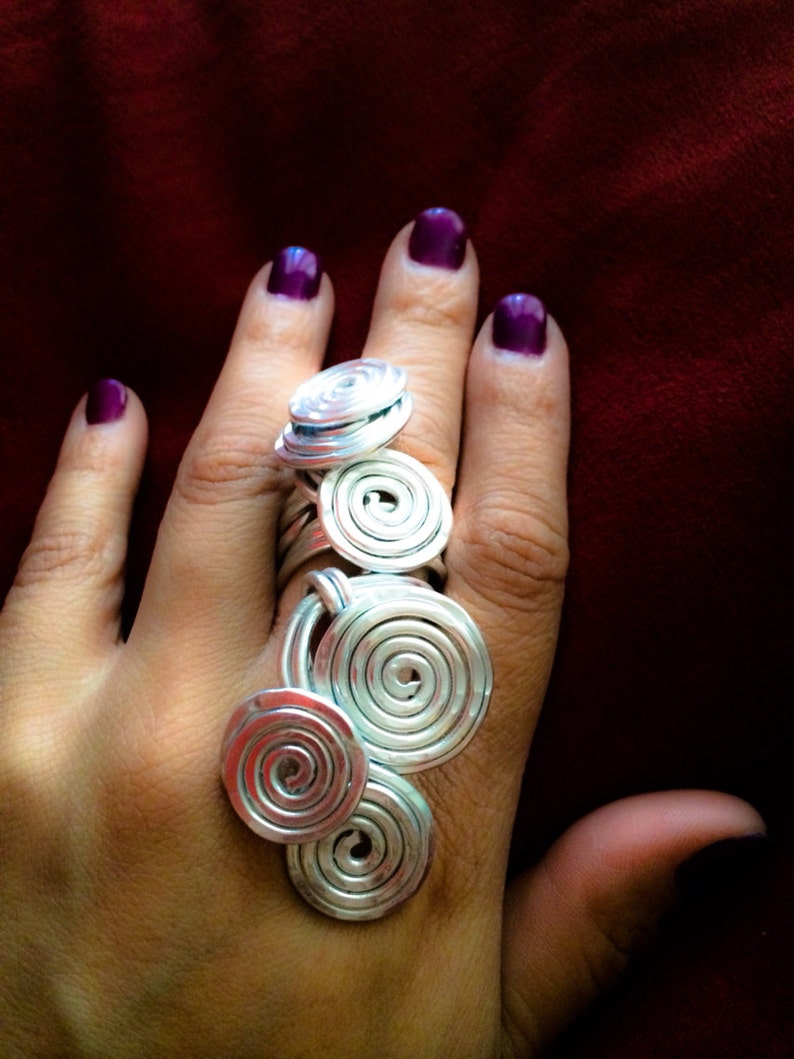 COILED AGAIN:  Bangin Beauties hammered aluminum statement image 0