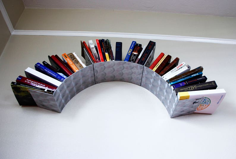 Sun Wall Bookshelf Engine Turned