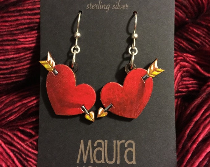 Hand painted shot through the heart earrings that are laser cut and hand painted to give the illusion of 3D.