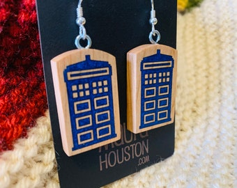 Tardis earrings that are inlayed with resin on solid cherry wood