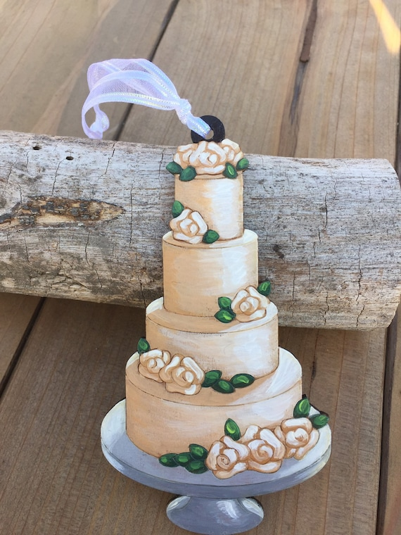 Wedding Cake Ornament laser cut and hand painted to give the illusion of 3D, it is flat