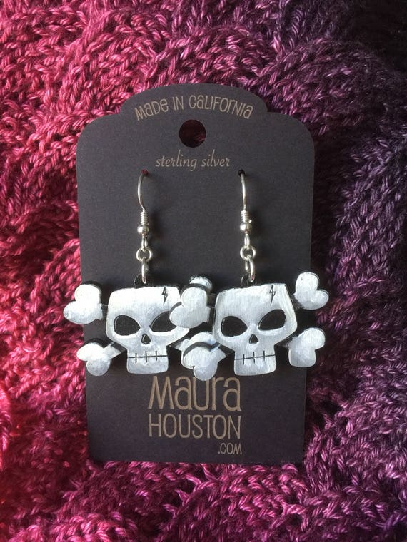 Skull and Crossbones Earrings that are laser cut and hand painted to gift the illusion of 3D // gifts for her // halloween