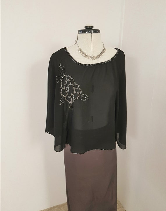 beaded black top, very dark, big sleeves, pullover