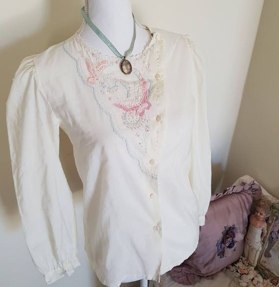 beige embroidered blouse, edwardian look with butt
