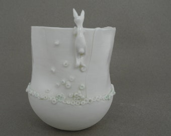 Cup in white porcelain with a rabbit - handmade ceramic whimsical vessel