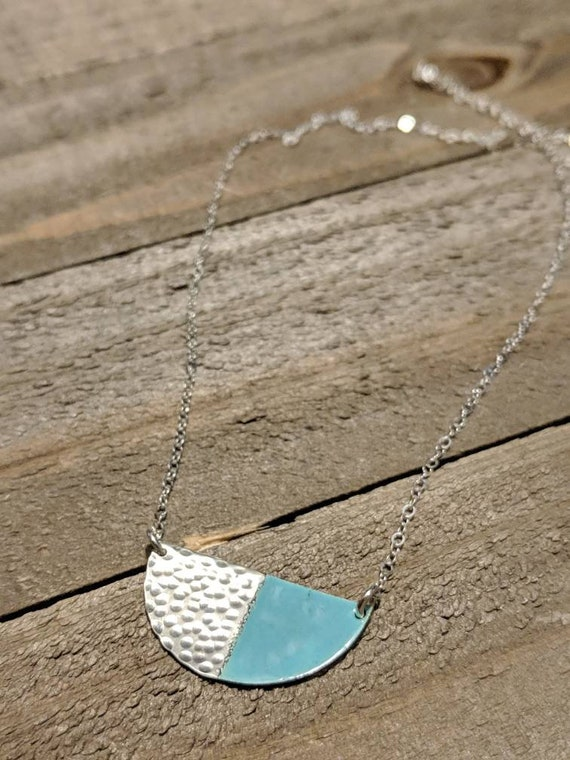 dappled silver and enamel half moon