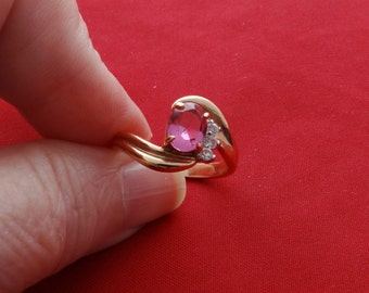 Vintage 14KGE signed gold tone pink and clear rhinestone ring,condition is unworn, sizes 5.5, 6 & 9