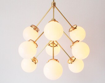 Modern Brass Chandelier, 9 White Glass Globes, Statement Chandelier Lighting Fixture, BootsNGus Lighting and Home Decor
