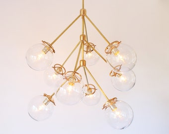Modern Brass Chandelier, 9 Clear Glass Globes, Statement Chandelier Lighting Fixture, BootsNGus Lighting and Home Decor