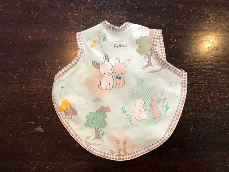 Baby bib in pastels with bunnies on blue background  modern image 0