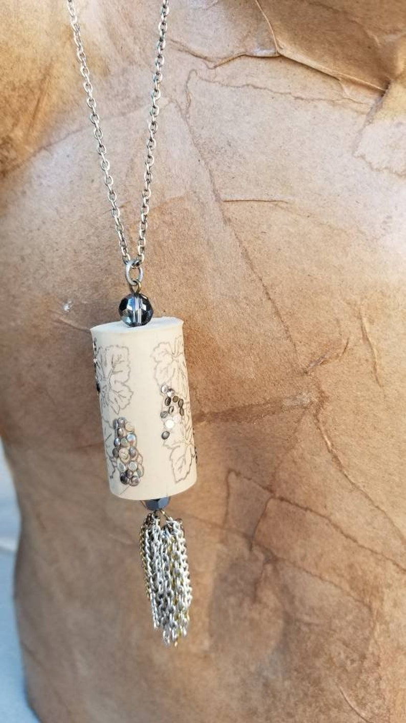 glass beads Wine Cork Pendant with Grape Leaf Motif embellished with nail heads and repurposed chain tassel.