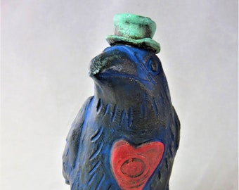 Ceramic crow raven sculpture celitc hat and heart Artisan made sculpture