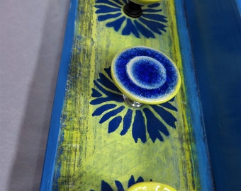 Cobalt blue daisies and bold yellow painted wooden jewelry holder shelf with ceramic knobs