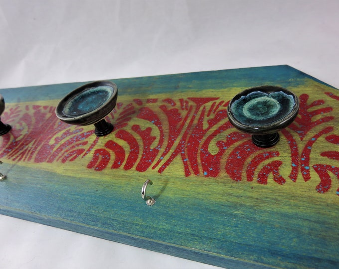 Salvaged wood seagreen and red wall hanger jewelry hanger with glass ceramic knobs parallelogram shape