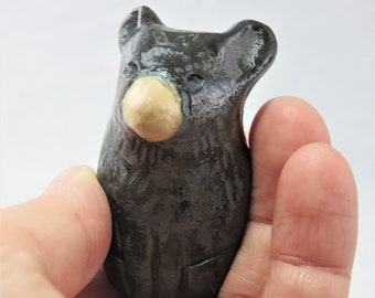 Tiny black bear made ceramic sculpture