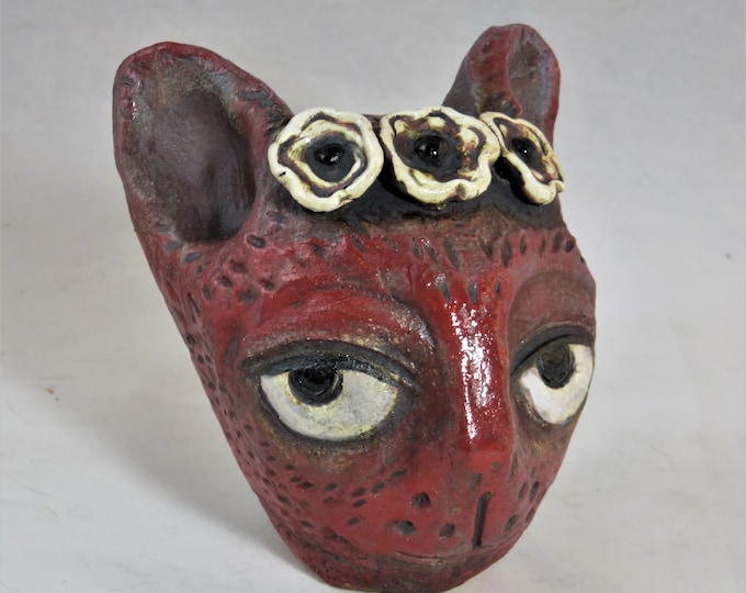 Irreverent red metallic ceramic kitty with flower crown  garden sculpture artisan made