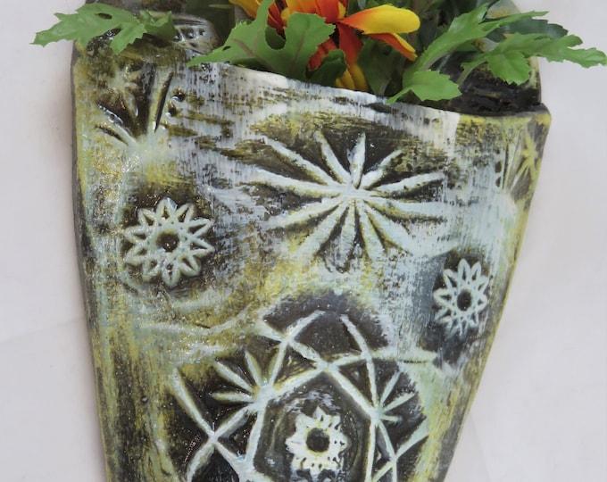 Vintage pattern artisan made ceramic wall pocket